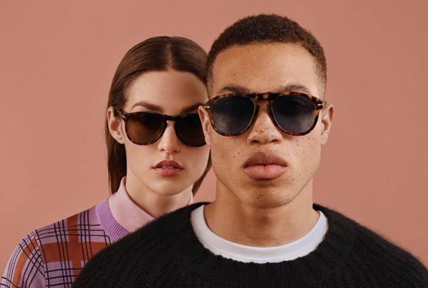 Man and woman wearing Persol sunglasses