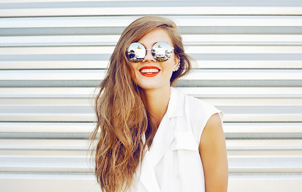 Woman smiling wearing sunglasses